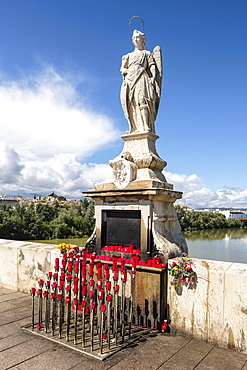 Statue of Archangel San Rafael, circa 1651, on the Puente Romano, Roman Bridge over the the Guadalquivir river, Cordoba, Andalucia, Spain