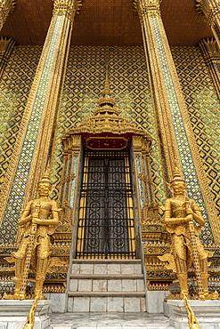 Temple of the Emerald Buddha golden guardians, Grand Palace, Bangkok, Thailand