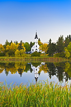 Ukrainian Catholic Church reflected in a lake, Camrose, Alberta, Canada