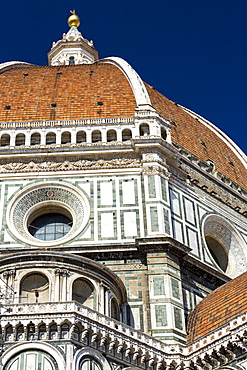 Close-up of Brunelleschi's Dome of Florence Cathedral decorative details of facade and blue sky, Florence, Tuscany, Italy