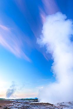 Strokkur geyser erupting at dusk, Geysir, Iceland