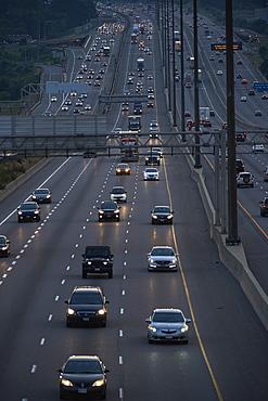 Highway 401 looking West towards Yonge Street at dusk, Toronto, Ontario, Canada