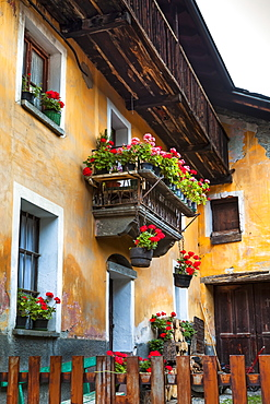 Historic building with flower pots, Dolonne, near Courmayeur, Aosta Valley, Italy