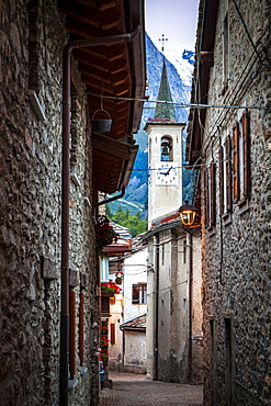 Ancient cobblestone streets lead to a church, Dolonne, near Courmayeur, Aosta Valley, Italy