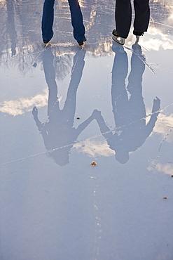 Reflection of a couple ice skating, Frog Pond, Boston Common, Boston, Suffolk County, Massachusetts, USA