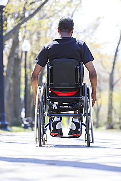 Man in a wheelchair who had Spinal Meningitis