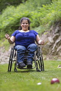 Woman with Spina Bifida in a wheelchair playing bocce ball - 1116-49915