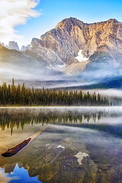 Tranquil lake with reflections in Elk Lakes Provincial Park; British Columbia, Canada