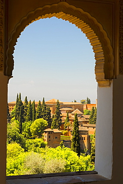 Arched window with a view from Alhambra; Granada, Andalusia, Spain