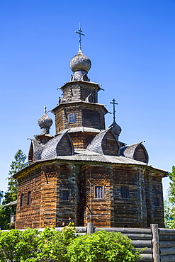 Wooden church building with onion domes and crosses, Museum of Wooden Architecture; Suzdal, Vladimir Oblast, Russia