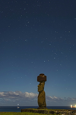 A single moai at night against a starry sky; Easter Island, Chile