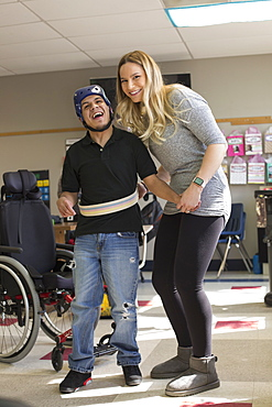 Boy with Spastic Quadriplegic Cerebral Palsy and teacher at school