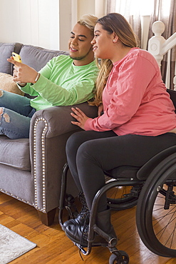 Woman who has Spinal Cord Injury reading a text with her brother