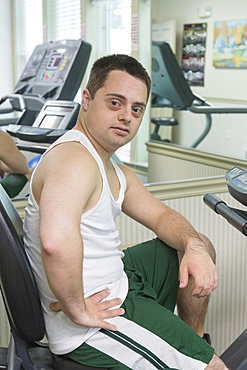 Man with Down Syndrome exercising in a gym