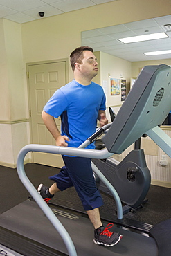 Man with Down Syndrome running on treadmill