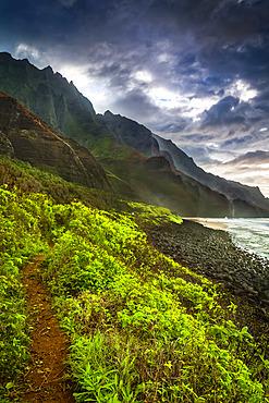 Rugged mountains of Na Pali Coast and Kalalau Beach in morning light, viewed from Kalalau Trail, Na Pali Coast State Park; Kauai, Hawaii, United States of America