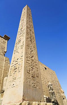 Obelisk, Colossi of Ramses II in Front of Pylon, Obelisk, Luxor Temple, UNESCO World Heritage Site; Luxor, Egypt