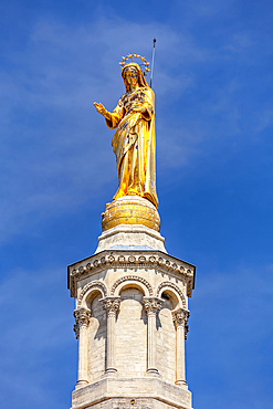 Golden statue of the Virgin Mary at Avignon Cathedral by the Palais des Papes; Avignon, France