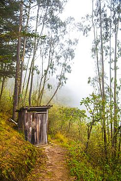 Rustic outhouse in Ecuadorian mountains; Calicali, Ecuador