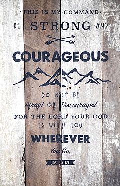 Bible verse on barn board sign with hand-painted lettering, Joshua 1:9; Calicali, Ecuador
