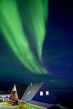 Northern Lights over the coastline and houses of Nuuk, Greenland; Nuuk, Sermersooq, Greenland