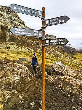 Female hiking on a trail in Southern Iceland; Grimsnes- og Grafningshreppur, Southern Region, Iceland