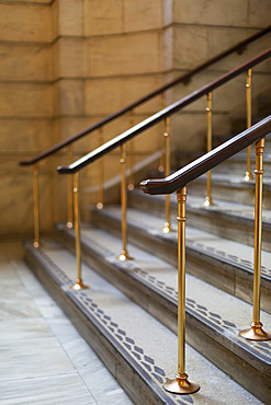 Decorative handrails and patterns on the edges of steps inside a building in Manhattan; New York City, New York, United States of America