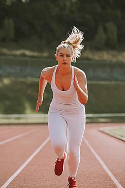 Woman running on a track; Wellington, New Zealand