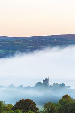 Castlebawn on the banks of Lough Derg surrounded in fog and mist at sunrise in autumn; Ogonnelloe, County Clare, Ireland