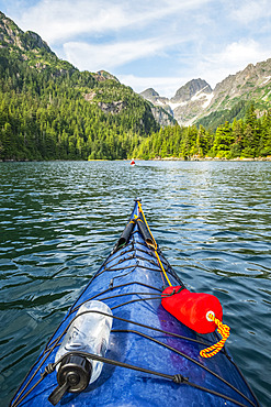 Kayaker paddling in Prince William Sound; Alaska, United States of America