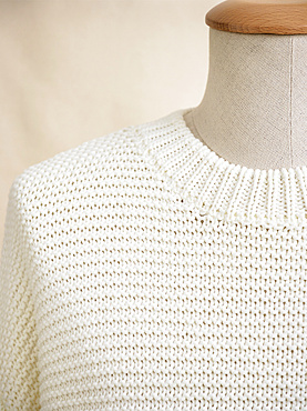 White knit sweater on mannequin; Studio