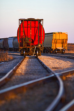 Freight trains on tracks after a switching station; Alberta, Canada