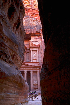 Glimpse of the Treasury from the Siq, Petra, UNESCO World Heritage Site, Jordan, Middle East
