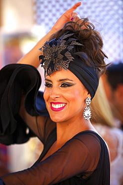 Flamenco dancer in traditional dress, Annual Horse Fair, Jerez de la Frontera, Cadiz Province, Andalusia, Spain, Europe