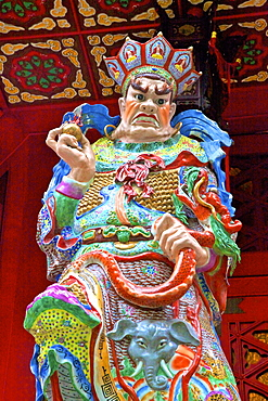 Statue of Virupaksa, one of The Four Heavenly Kings at Wong Tai Sin Temple, Hong Kong, China, South East Asia