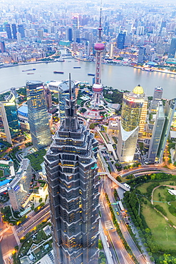 View over Pudong financial district at dusk, Shanghai, China, Asia