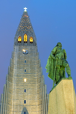 The Hallgrims Church with a statue of Leif Erikson in the foreground lit up at night, Reykjavik, Iceland, Polar Regions