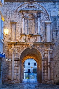Land Gate illuminated at dusk, Stari Grad (Old Town), Korcula Town, Korcula, Dalmatia, Croatia, Europe