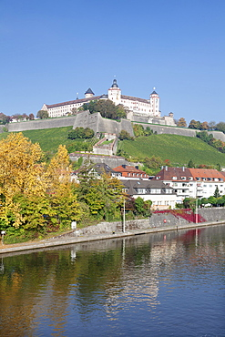 View over the Main River to Marienberg Fortress in autumn, Wuerzburg, Franconia, Bavaria, Germany, Europe