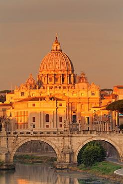 View over Tiber River to Ponte Vittorio Emanuele II Bridge and St. Peter's Basilica at sunrise, Rome, Lazio, Italy, Europe