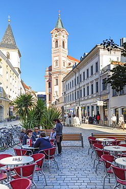 Cafe on Rindermarkt square by St. Paul Church in Passau, Germany, Europe