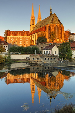 View over Neisse River to St. Peter and Paul Church at sunrise, Goerlitz, Saxony, Germany, Europe
