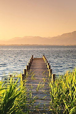 Jetty at sunrise, Gstadt am Chiemsee, Lake Chiemsee, Upper Bavaria, Germany, Europe