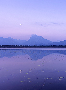 Allgau Alps reflecting in Hopfensee Lake at moonrise, near Fussen, Allgau, Bavaria, Germany, Europe