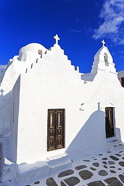 Whitewashed Panagia Paraportiani, Mykonos most famous church, under a blue sky, Mykonos Town (Chora), Mykonos, Cyclades, Greek Islands, Greece, Europe