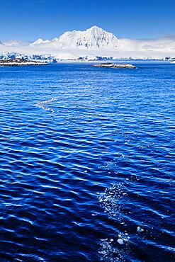 Misty Mount William under a blue sky, from the sea off Anvers Island, Antarctic Peninsula, Antarctica, Polar Regions