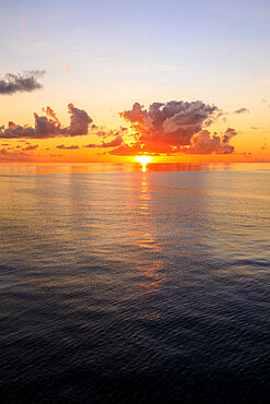 Sunset over beautiful calm sea, interesting clouds, vibrant colours, St. Kitts, St. Kitts and Nevis, Leeward Islands, West Indies, Caribbean, Central America