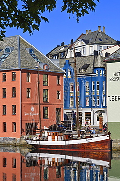 Art Nouveau buildings and reflections with boat, Alesund, More og Romsdal, Norway, Scandinavia, Europe