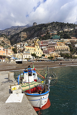 Fishing boat at quayside and Positano town, Costiera Amalfitana (Amalfi Coast), UNESCO World Heritage Site, Campania, Italy, Europe
