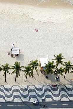 Elevated view of the beach with the famous wavy dragons tooth paving on Avenida Atlantica, Copacabana, Rio de Janeiro, Brazil, South America